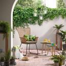 Fauteuil en rotin et métal indoor/outdoor Sanders en extérieur
